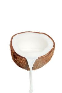 Coconut Milk poured from a Mature Coconut